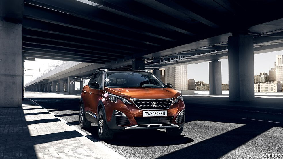 Orange Peugeot 3008 SUV under the bridge